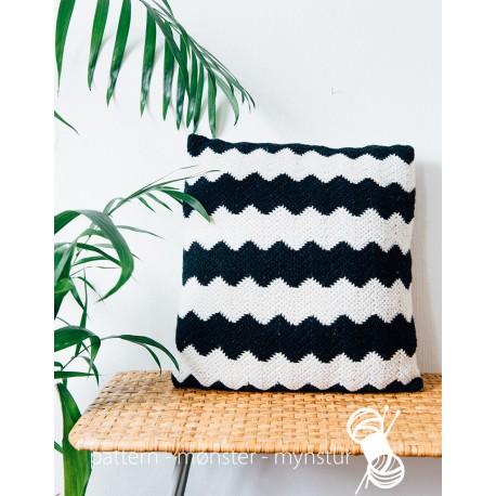 Sort og hvid pude med zigzag