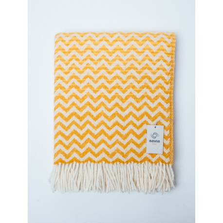 Yellow woven blanket with a wavy pattern
