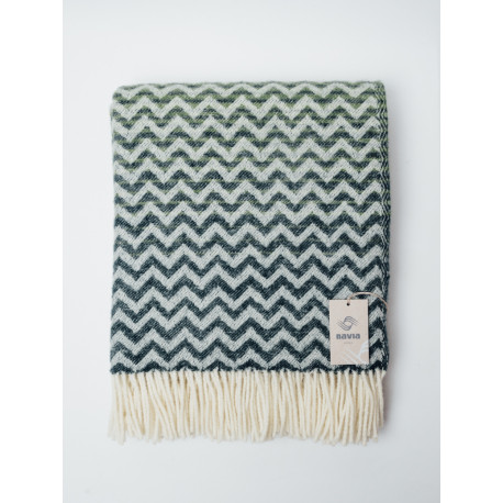 Green woven blanket with a wavy pattern