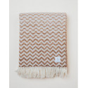 Brown woven blanket with a wavy pattern